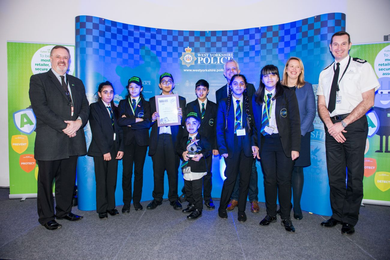 PCC Mark Burns-Williamson with Chief Constable John Robins and the winners of the 2019 West Yorkshire Police Schools Cyber Competition, Carlton Bolling College