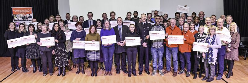 Image from the Safer Communities Fund Awards showing all the projects with their cheques
